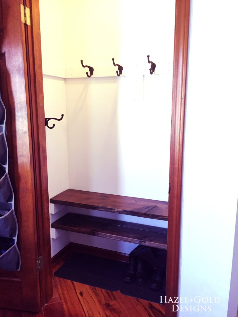 closet renovation, hooks and bottom shelves installed
