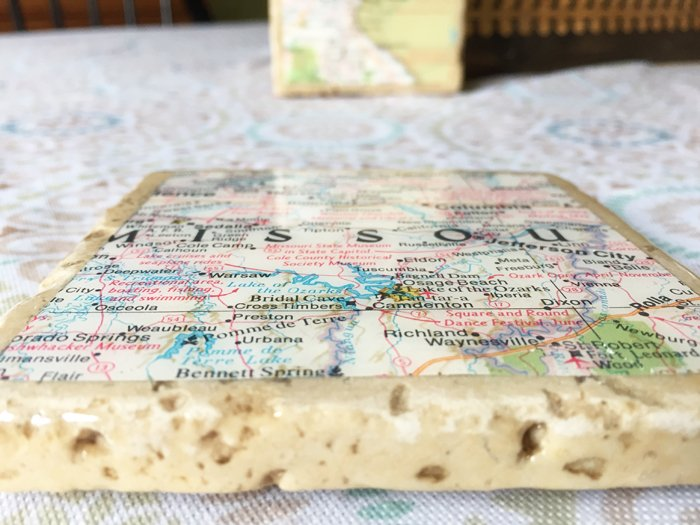 geographic tile coasters - close up showing map and resin in holes of tile - Envirotex Lite