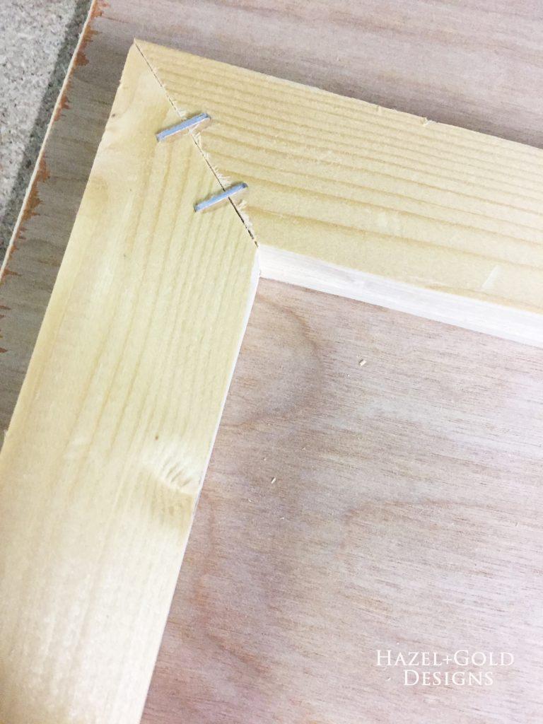 wooden heart decor back of frame