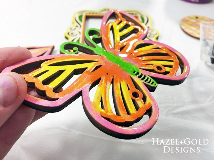 Shiny Wood Cutouts - Butterfly partly covered in resin