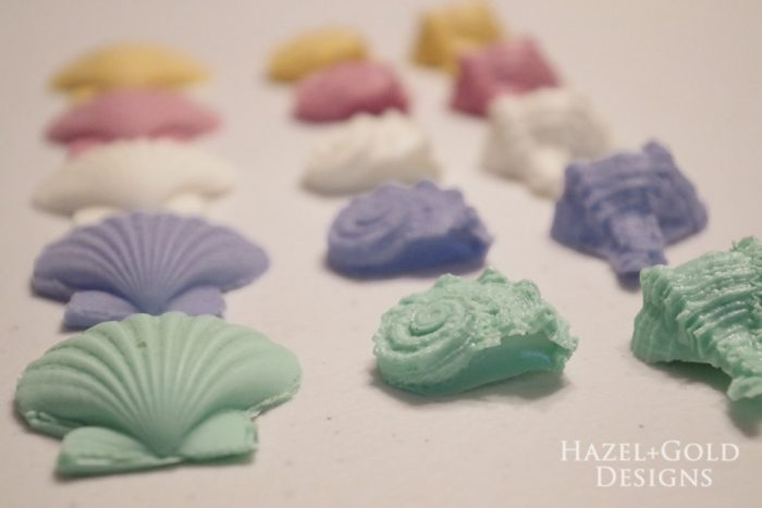 Hazel and Gold Designs making seashell wall art with FastCast resin - Make multiple colors of your casting and arrange them to see how you want your art to turn out