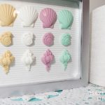 Hazel and Gold Designs making seashell wall art with FastCast resin - Secure your castings inside a shadowbox to make it into wall art!