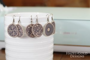 Cricut Family Gifts - Leather pendants and pencil holder- finished earrings hanging on jar