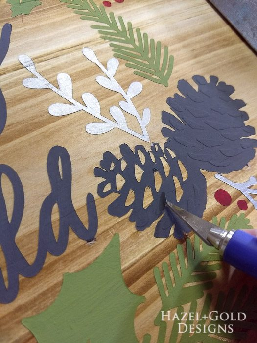 DIY Joy to the World Wooden Sign- don't forget to remove small pieces of stencil