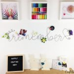 DIY memo board bent wire lettering that reads the word remember