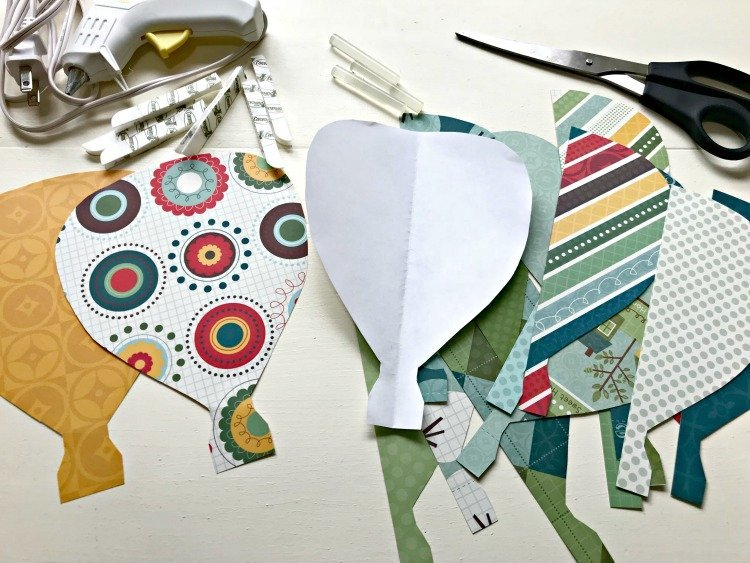 DIY Paper Hot Air Balloons supplies: Scrapbook Paper, scissors, glue gun, and hot air balloon templates.