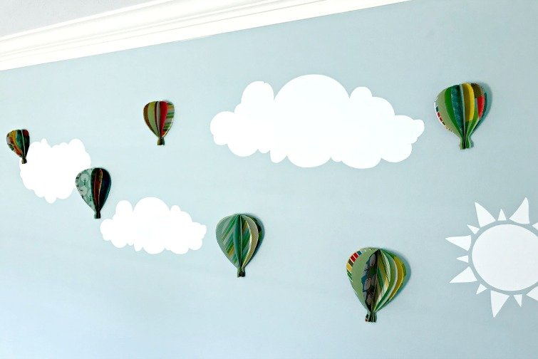 6 Scrapbook Paper Hot Air Balloons on a blue wall with white vinyl clouds.