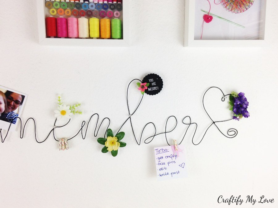 bending wire into the word remember to create a DIY memo board
