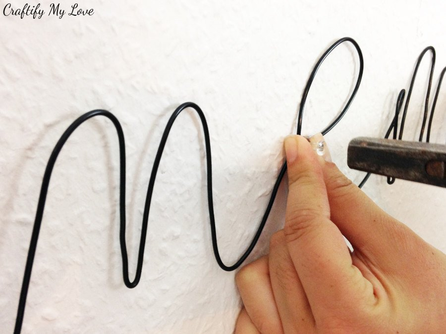 installing diy wire photo holder with clear pins to wall