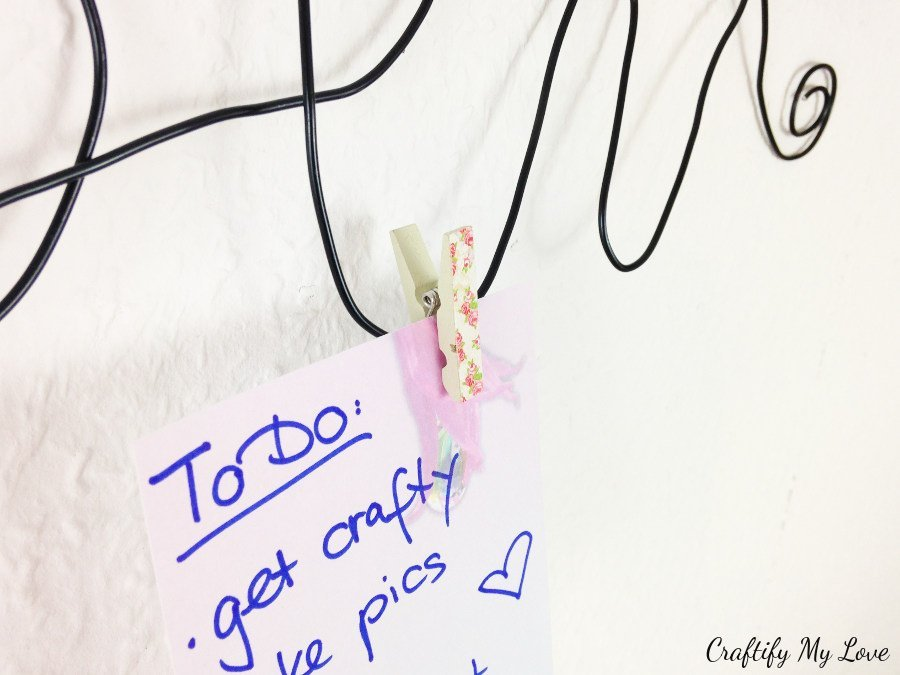 pinning chore list to hand formed wire memo board