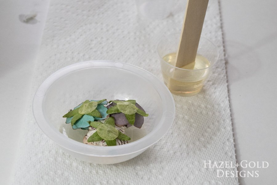 Layering Resin to make paperweight- place the flowers inside on top of your cured resin, pour new layer of clear resin