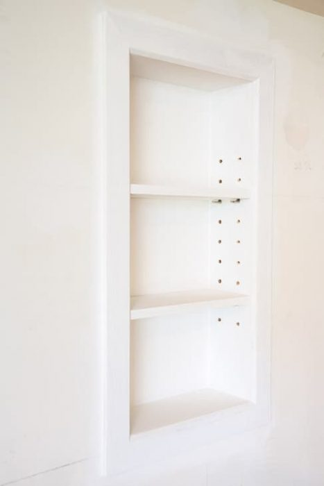 DIY Recessed Bathroom Shelves by The Handyman's Daughter