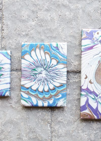 Acrylic Paint Pouring Art - Two Pours- Final photo of three on bricks
