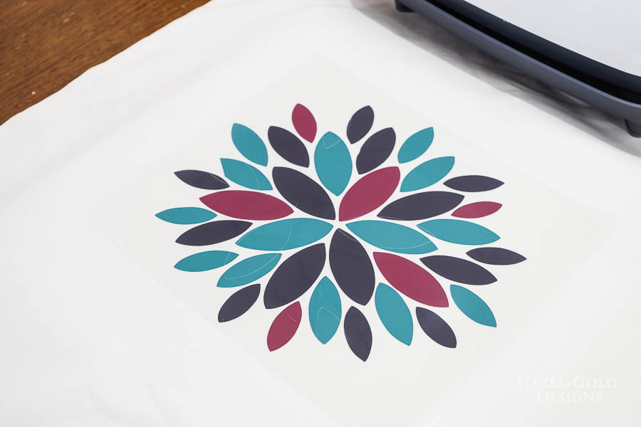 Modern Flower Pillow Cover using Cricut EasyPress 2 - put wine iron on down and press with EasyPress 2 for 5 seconds