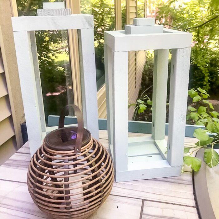 2 wood lanterns on outdoor kitchen counter