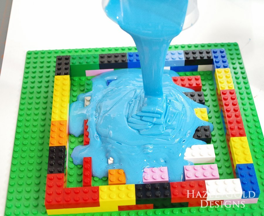 DIY Lego Mold- begin pouring slowly into center of mold space