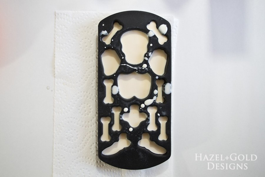 DIY Resin Framed Skeleton Halloween Decor - Let resin cure for 10 minutes