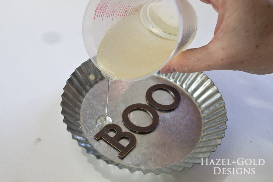"""Boo"" Decorative Galvanized Hanging Tin DIY Tutorial - pour resin into the tin"
