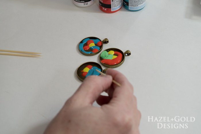 Paint and Resin Necklaces- drag toothpick through paint to create design