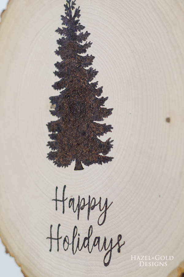 DIY Reversible Holiday Wood Slice Sign using Pyrography- closeup of christmas side
