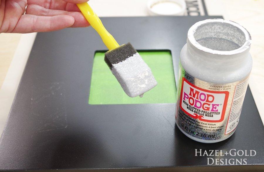 Glitter ModPodge Mirror Frame_- dip sponge brush into glitter modpodge