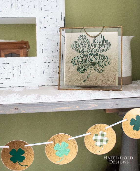 St. Patrick's Day Home Decor using the Cricut Maker - Learn how I made these St. Patrick's Day banner and artwork decorations using my Cricut Maker machine. Quick, easy and very festively green and gold! #cricutmade #cricutmaker #cricutprojects @officialcricut