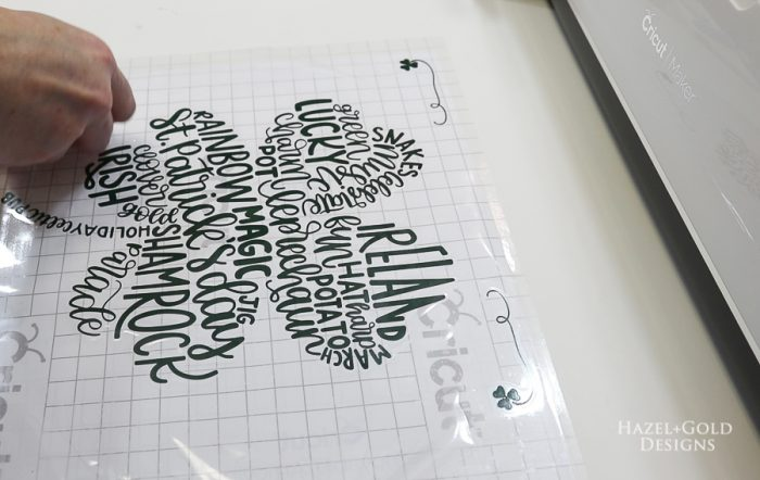St Patricks Day Art using Cricut Maker - place transfer tape over vinyl words