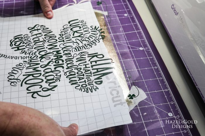 St Patricks Day Art using Cricut Maker - place vinyl words onto textured metallic vinyl