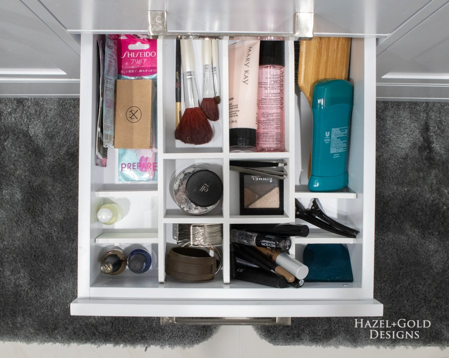 DIY bathroom drawer organizer filled top view
