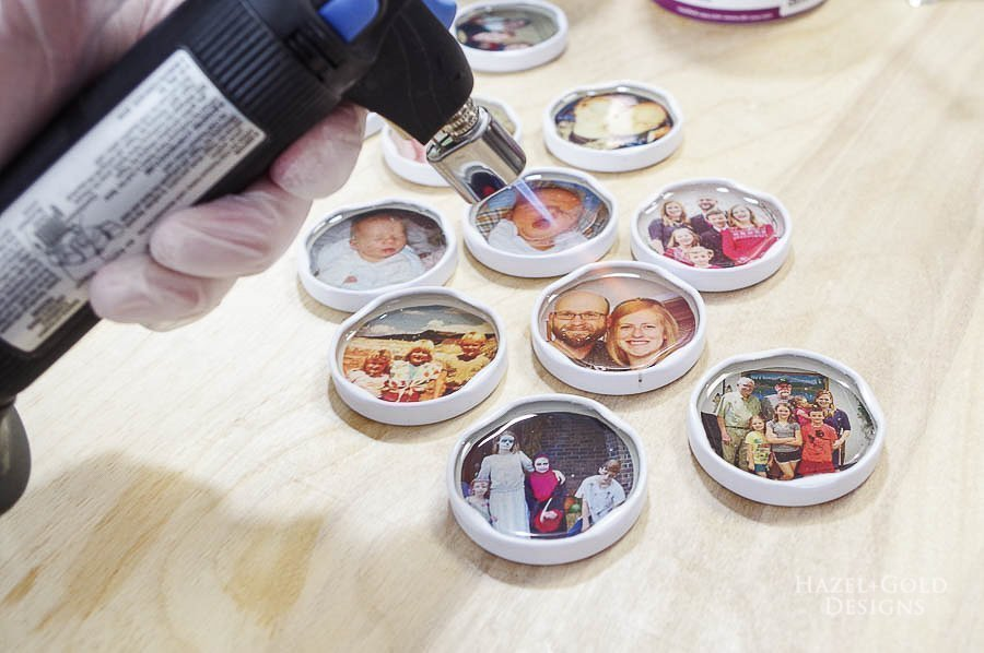 use micro butane torch to pop the bubbles - how to make photo magnets with resin
