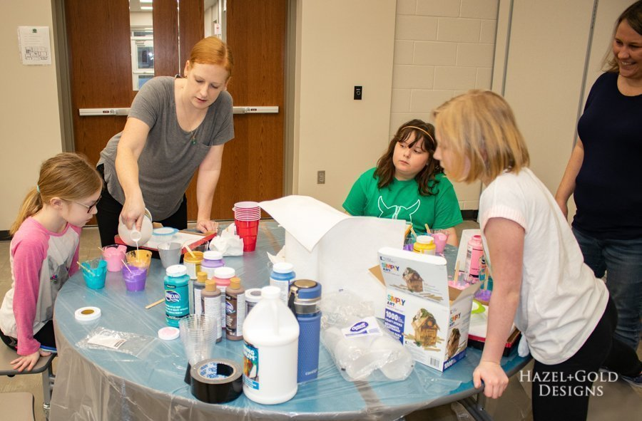 paint pouring - mixing the paints - brownie girl scout painting badge activity