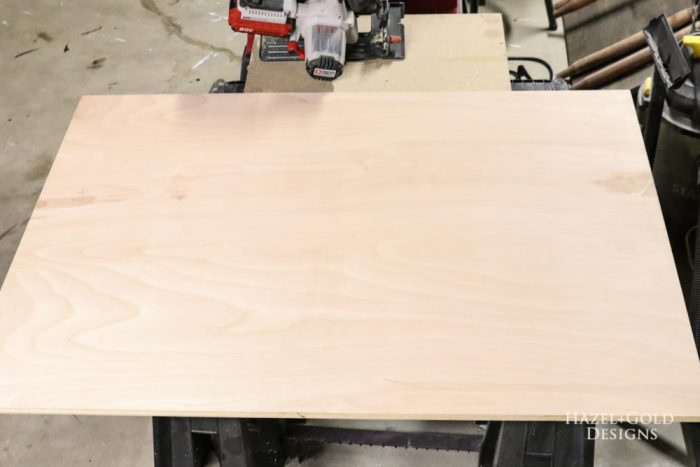 "Cut plywood to size. Mine is 36"" tall and 24"" wide."
