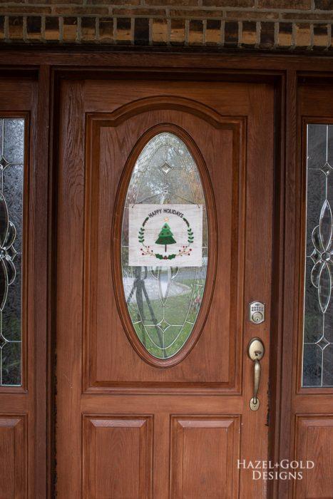 full door shot of happy holiday wreath door sign using scroll saw