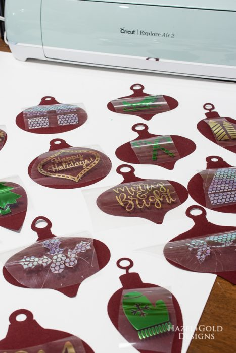 place shapes onto each ornament for holiday garland
