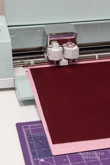 holiday garland - place fabric onto fabricgrip mat and cut with cricut explore air 2