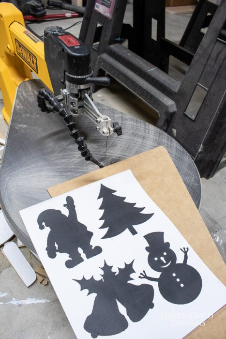 Gather cutting supplies for simple gold scroll saw ornaments