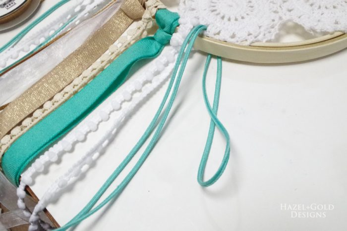 Fold the ribbon in half, place loop from front to back