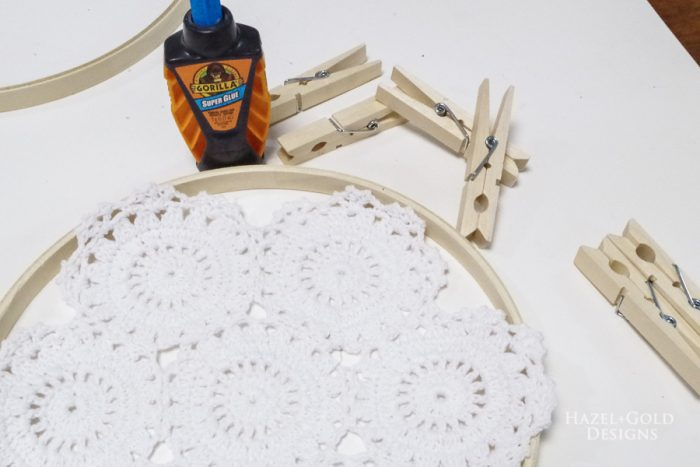 Gather supplies for glueing the doily dreamcatcher