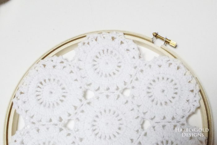 Place the outside of the embroidery hoop back around the outside.