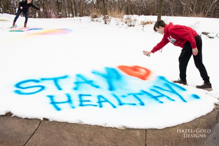 Stay Healthy message for neighbors using testors spray chalk