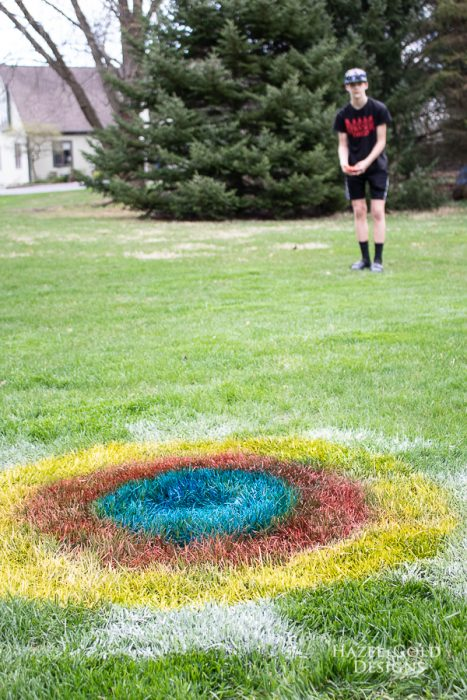 playing yard games with testors spray chalk target in grass